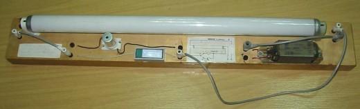 На картинке дроссель стартер для люминесцентных ламп